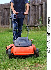 Mowing the Yard - Close up view of someone mowing the lawn