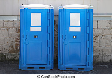 Chemical toilet - Two portable toilet cabins at construction...