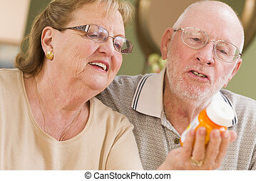 Senior Couple Reading Medicine Bottle - Curious Senior...