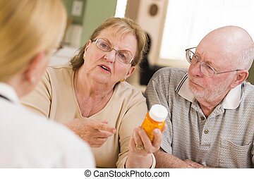 Doctor or Nurse Explaining Prescription Medicine to...