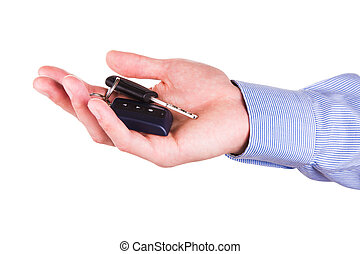 Male hand holding a car key . New car concept - Male hand...