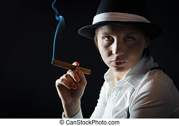 Woman in black hat with cigar in isolated
