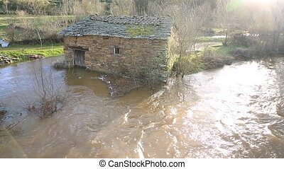 Flooding - Floodin over vintage stone made house water mill...
