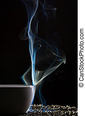 Smoke and cup with grain of tea