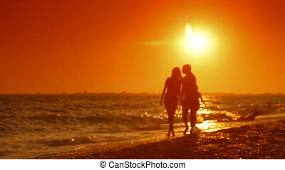 Teen Couple Summer Beach Vacation - Teenage couple walking...