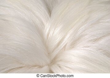 Goat Skin - A clouse up on a white shiny goat fur
