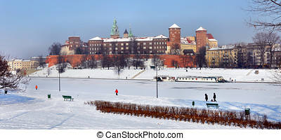 Wawel Castle in Krakow and frozen Vistula river - Winter...