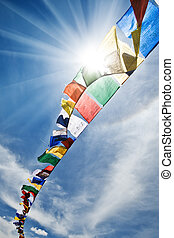 flags - tibetan flags with mantra on sky background