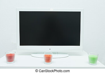flat screen tv - Flat screen television on table with...