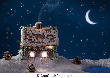 Smoke poured out of the gingerbread home at night