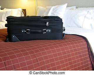 luggage in hotel room - luggage in the beds of a hotel room