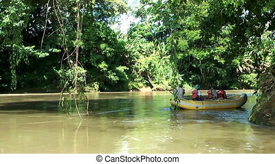 gliding with boat trough rainforest - gliding with an...