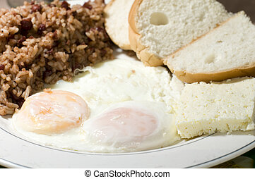 Nicaraguan cheese fried eggs breakfast with rice and bean...