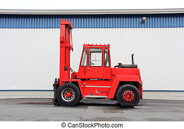 Red Forklift Truck - Red forklift truck by an industrial...