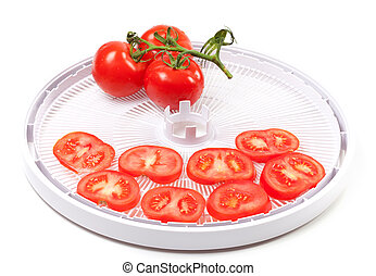 Ripe tomato on food dehydrator tray On white background