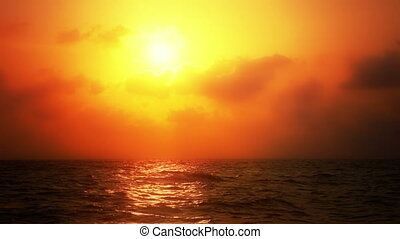 Ocean Sunset with Warm Coloration - Sun setting with warm...