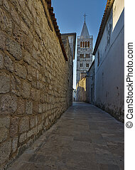 Bell tower at morning light - Bell tower and street in old...
