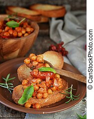 toast bread with chickpeas and tomatoes