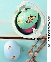 Easter colored eggs with spring flowers