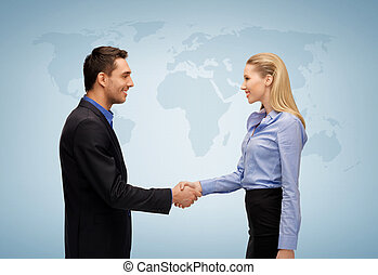 woman and man shaking hands - picture of businesswoman and...