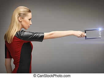 woman with sci fi weapon - picture of futuristic woman with...