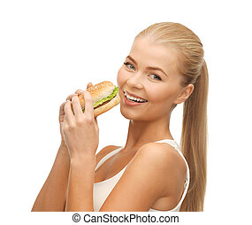 woman eating junk food - picture of healthy woman eating...