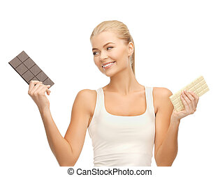 smiling woman with dark and white chocolates - picture of...