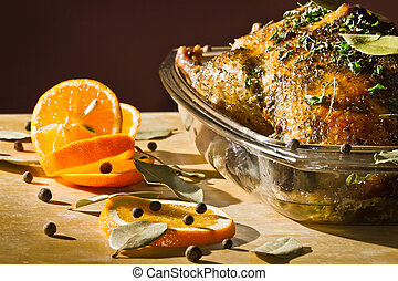 Chicken roasted with herbs serve with orange fruit