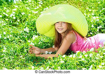big green hat - Happy summer girl having fun outdoors.