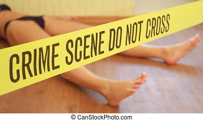 Crime scene - woman playing dead with boundary tape - crime...