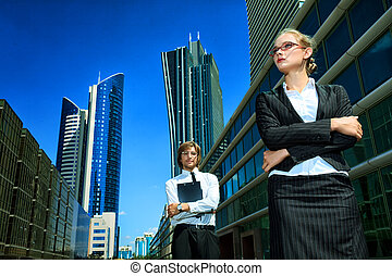 manufacturing - Business woman and business man standing in...