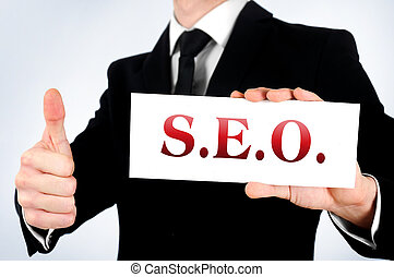Business man agreement - Business man showing SEO word