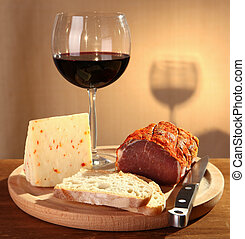 Red wine with Italian cheese and capocollo.