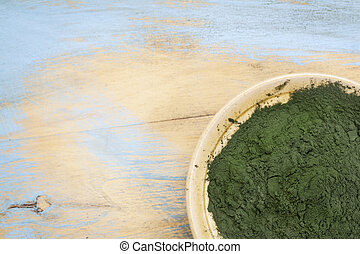 Hawaiian spirulina powder - small bowl of Hawaiian spirulina...
