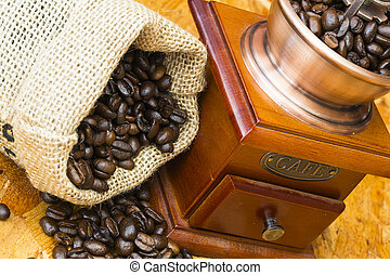 fresh roasted coffee beans and old coffee grinder - fresh...