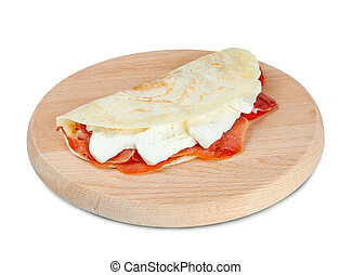 Italian piadina with ham and mozzarella cheese.