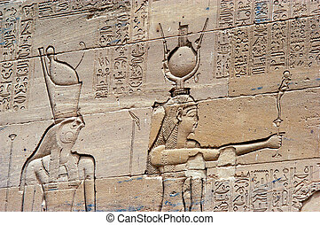 Aswan - Egypt - Ancient Egyptian artwork on a wall at Temple...