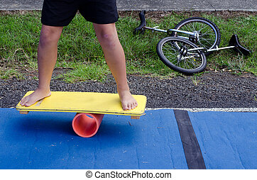 Balance board - Man on a Balance board in a local circus.