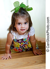 A child is climbing up stairs. - Little girl climbing up...