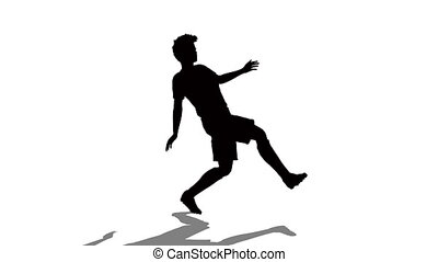 silhouette of man playing football