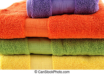 Bath towels - stock pictures of colorful bath towels stacked