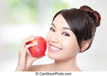 young woman eating red apple with health teeth - Beautiful...