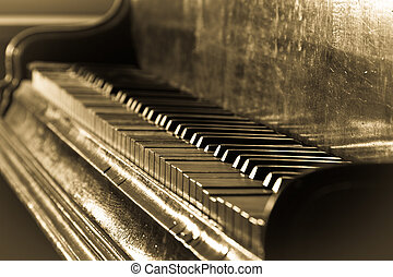 Antique piano and sepia toned