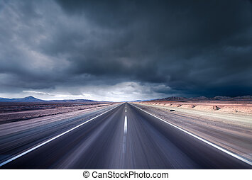 Day of Thunder - Road leading into a desert storm