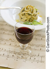 Red Wine And Pasta - Red wine with pesto spaghetti on an old...
