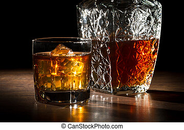 Carafe and glass with ice with whiskey