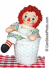 rag doll in wicker basket - Old rag doll in wicker basket.