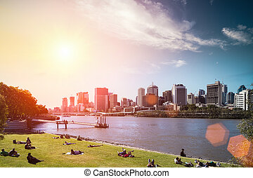 modern building with park in brisbane - brisbane skyline and...