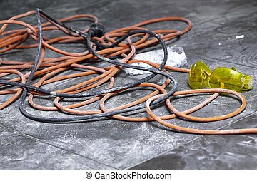 coils of electrical cable lying on floor workplace - Cable...