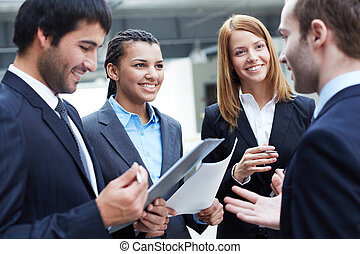 Sharing ideas - Group of business partners looking at their...